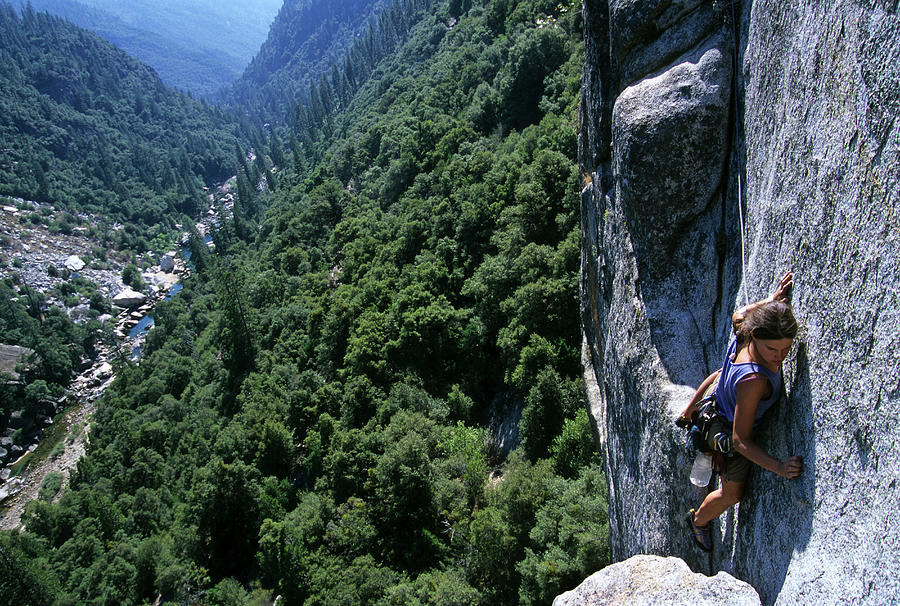 Woman Rock Climbing High Above River Photograph by Heath Korvola