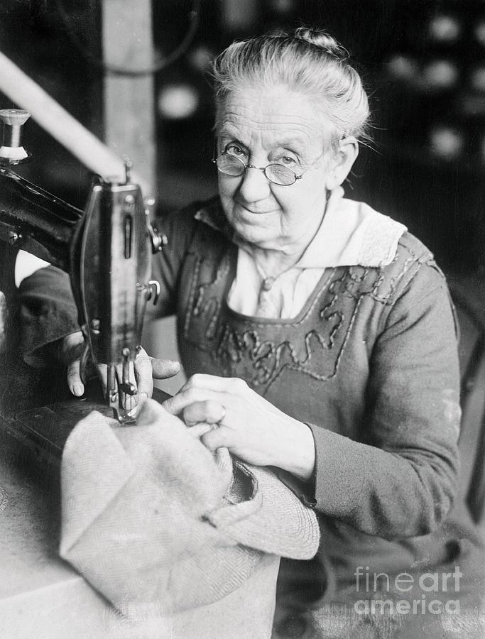 Woman Sewing A Cap Photograph by Bettmann