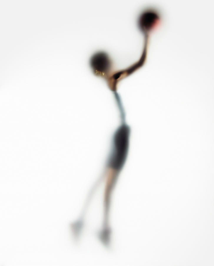Woman Shooting Basketball, Side View Photograph by Symphonie