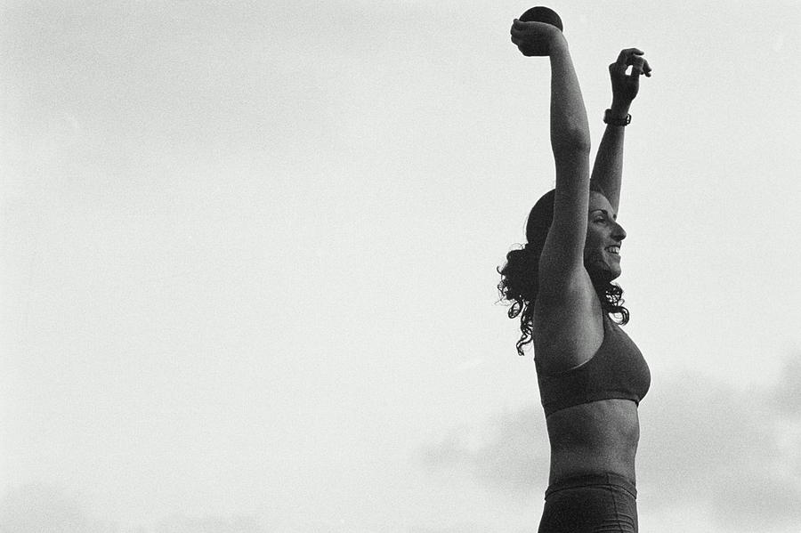 Woman Shot-putter With Arms In Air Photograph by Nathan Bilow