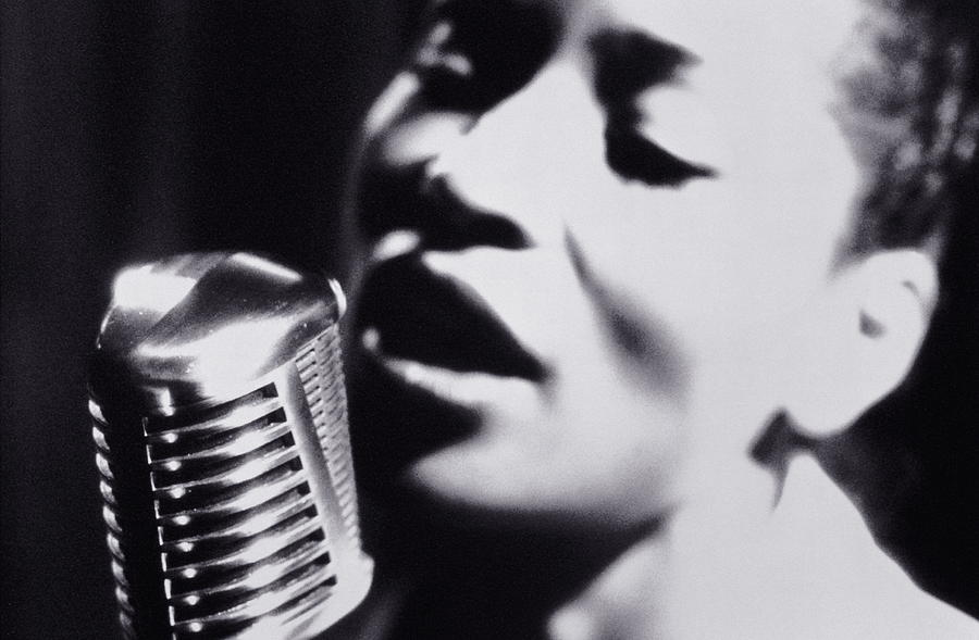 Woman Singing Into Microphone, Close-up Photograph by Nick Dolding