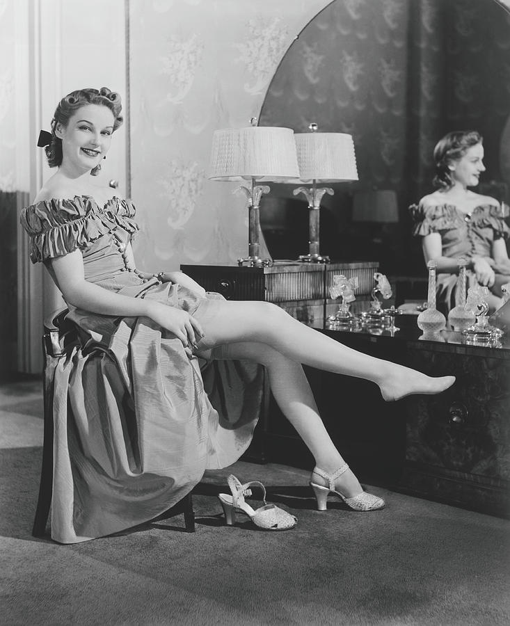 Woman Sitting At Vanity Table, Putting Photograph by George Marks