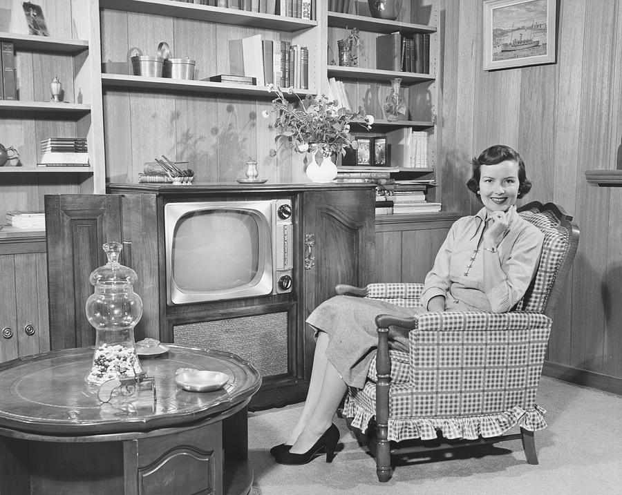 Woman Sitting In Armchair In Living Photograph by George Marks