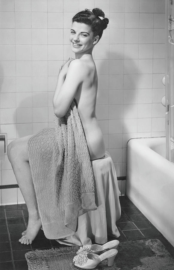 Woman Sitting In Bathroom, Covering Photograph by George Marks