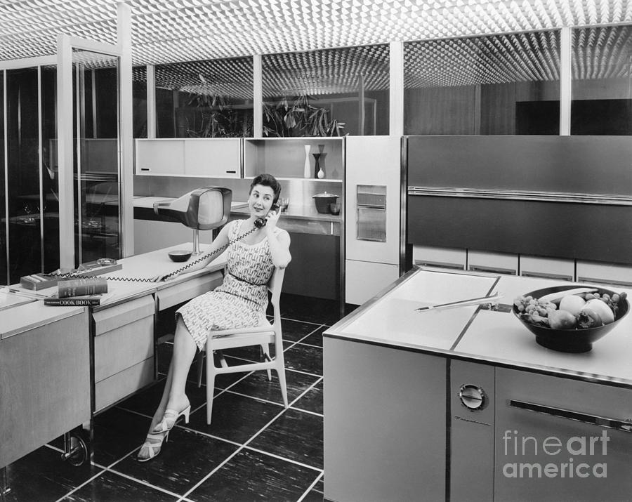 Woman Sitting In Kitchen Photograph by Bettmann