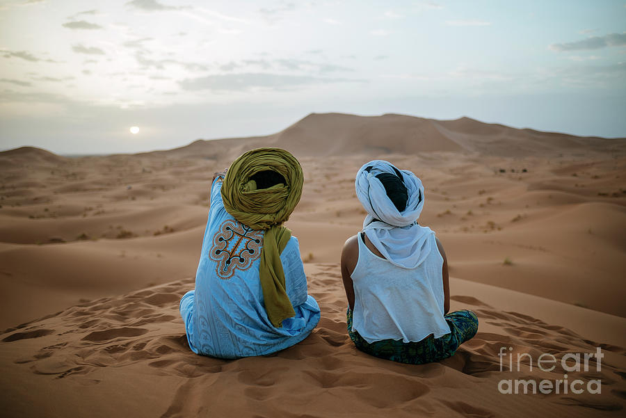 Woman Sitting In The Desert With Berber Photograph by Westend61