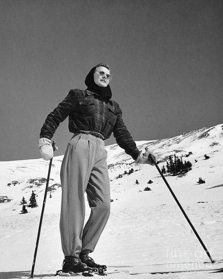 Woman Skier Standing On Slopes Photograph by Stockbyte