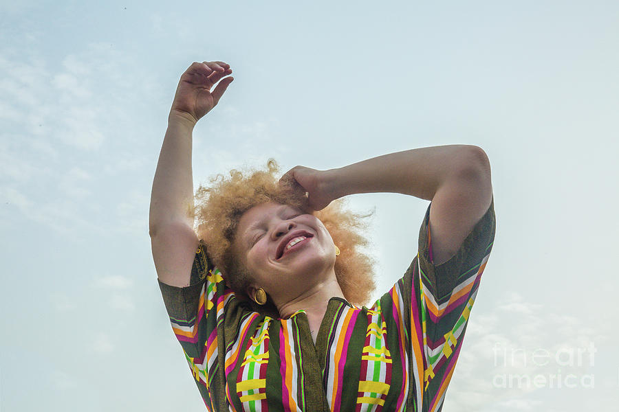 Woman Smiling Against Sky Photograph by Yagazie Emezi
