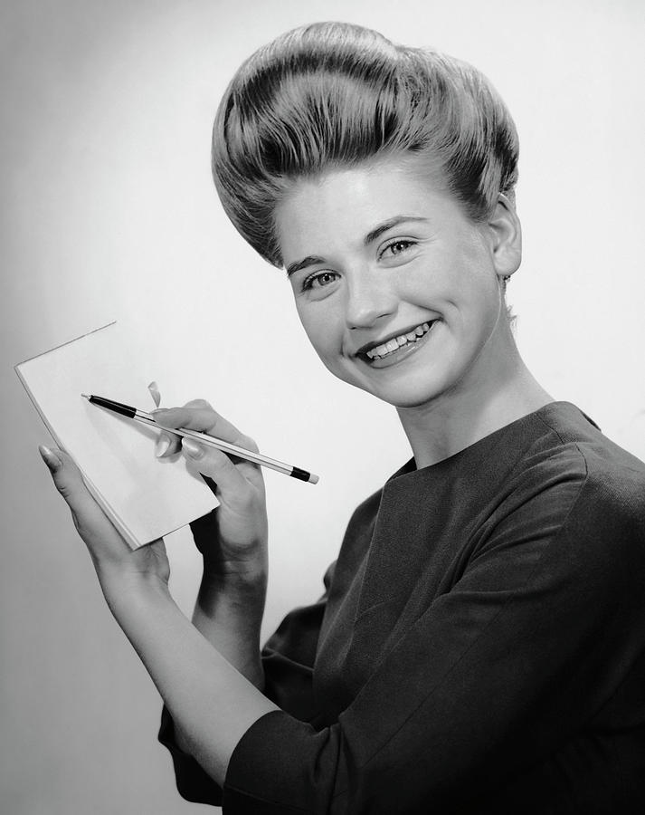 Woman Smiling Wpen & Pad Photograph by George Marks