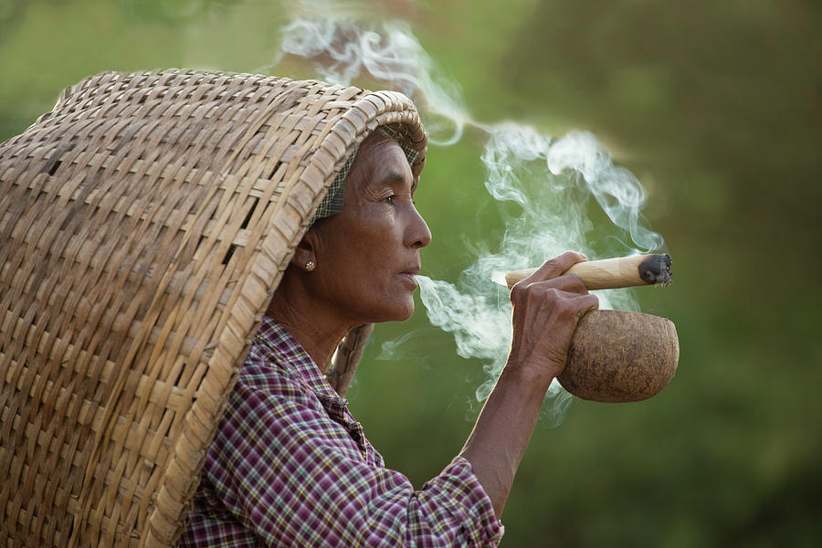 Woman Smoking in Myanmar by Lindley Johnson