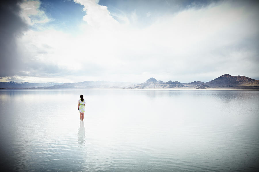 Woman Standing In Shallow Water Looking Photograph by Thomas Barwick
