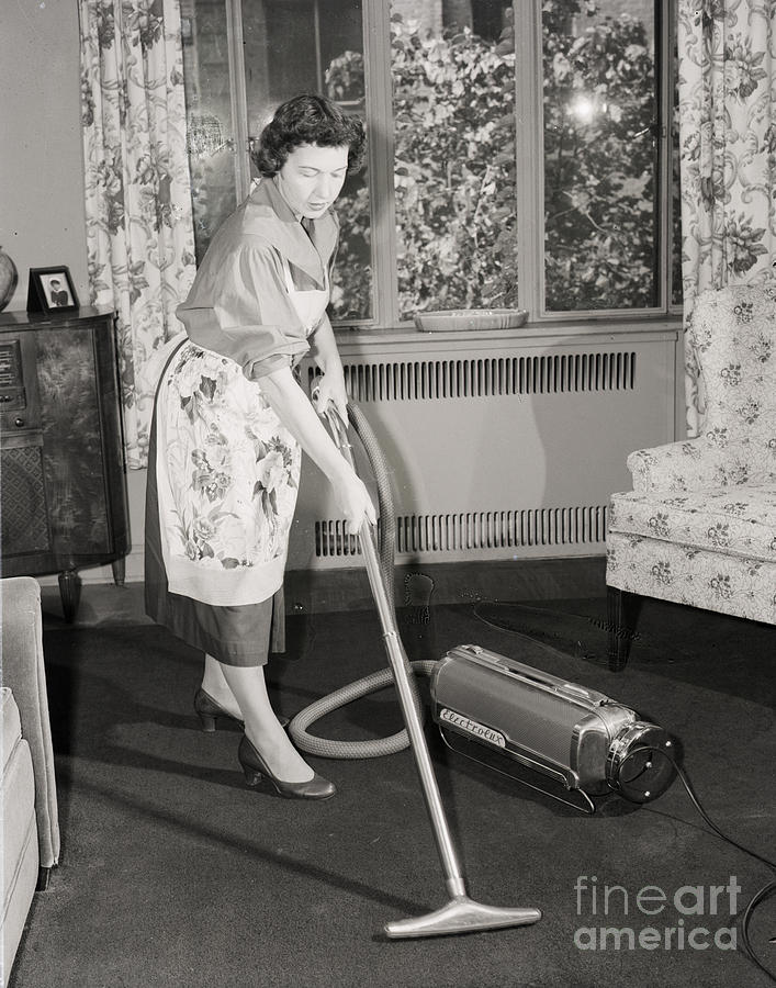 Woman Vacuuming Carpet Photograph by Bettmann