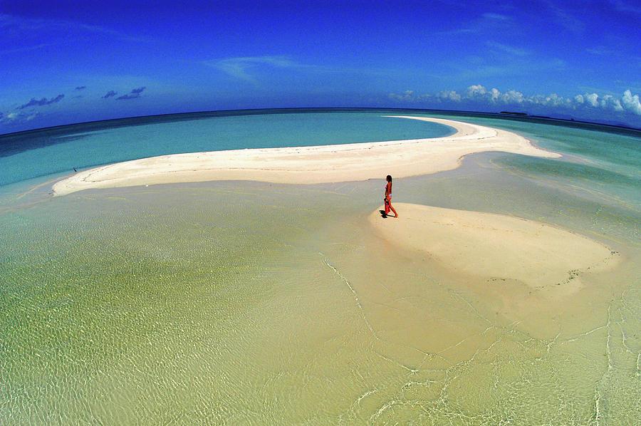 Woman Walking Along Sand Bar At A Photograph by Tim Rock