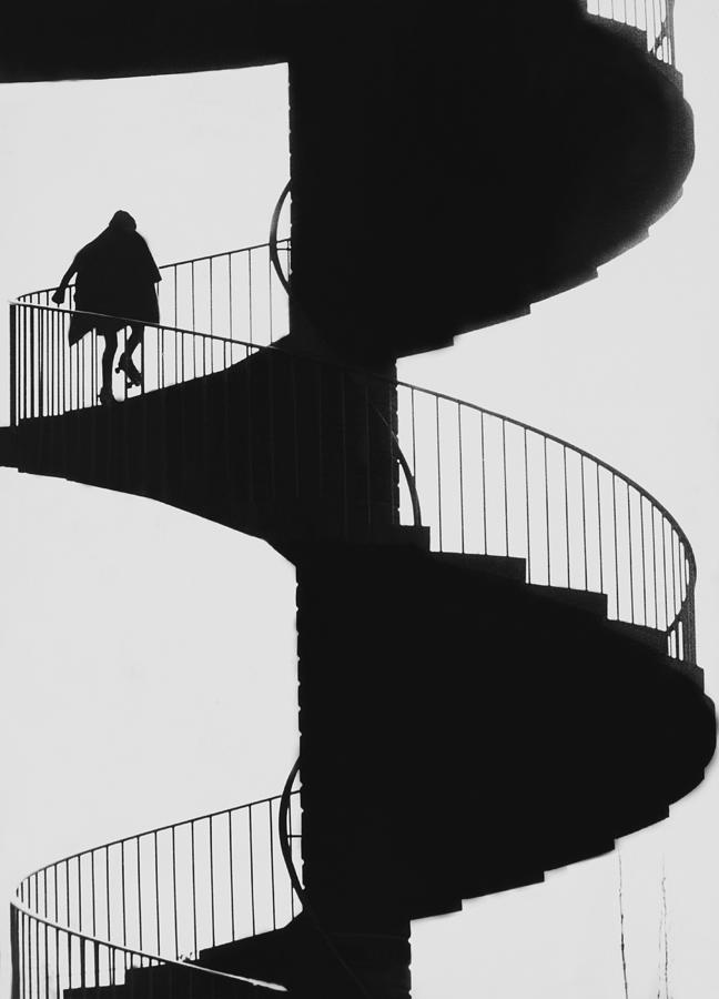 Woman Walking Up The Stairs With Photograph by Keystone-france