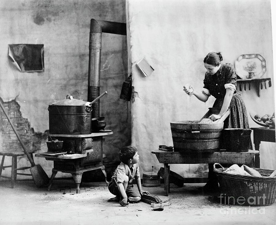 Woman Washing Boy On Floor Kitchen Photograph by Bettmann