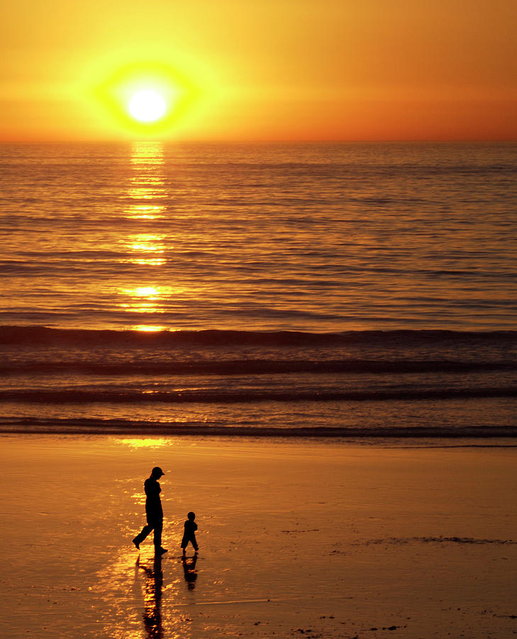 Toddler Photograph - Woman With Child On Beach by Skyak