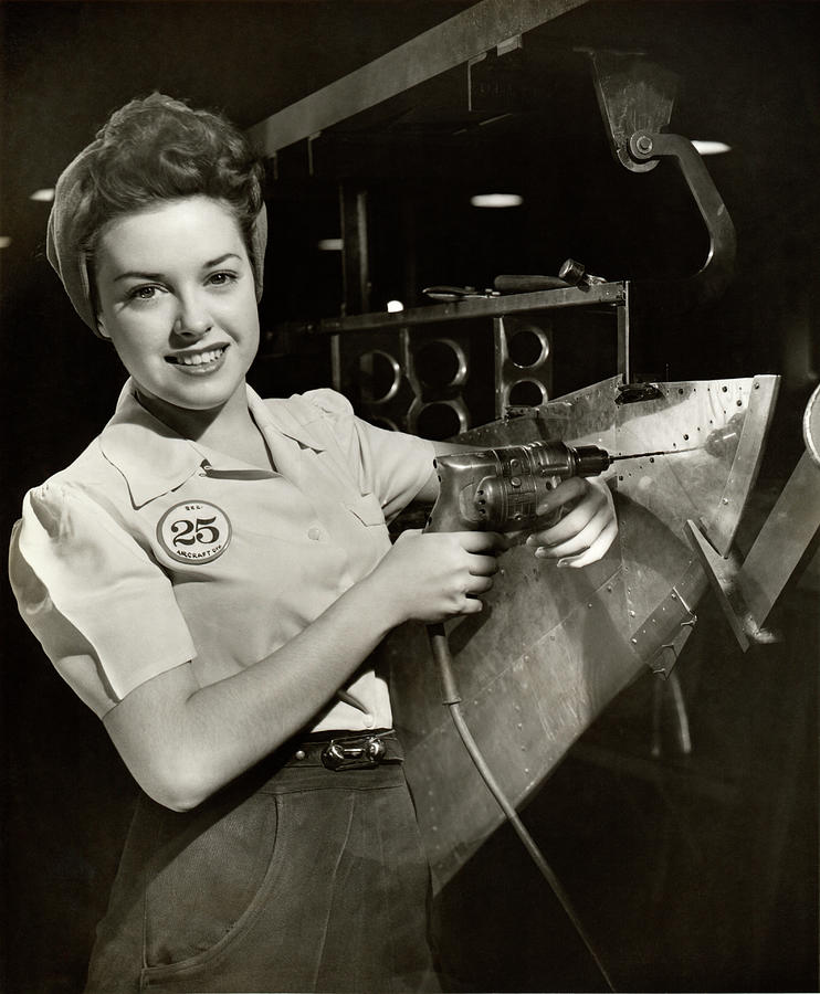 Woman Working On Aircraft Assembly Line Photograph by George Marks