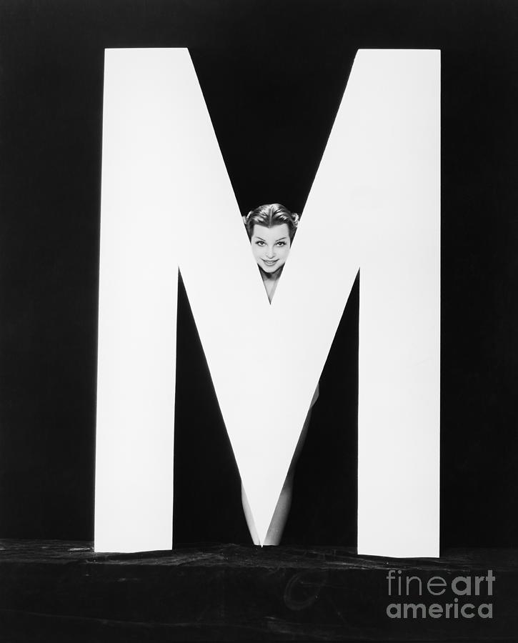 Behind Photograph - Womans Face With Huge Letter M by Everett Collection