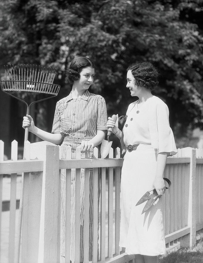 Women Chatting Over Fence Photograph by H. Armstrong Roberts