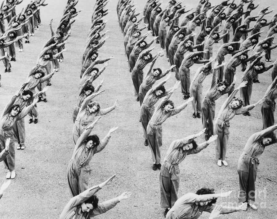 Women Doing Stretching Excercises Photograph by Bettmann