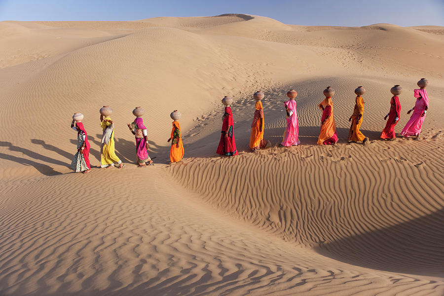 Women Fetching Water From The Sparse Photograph by Mint Images - Art Wolfe