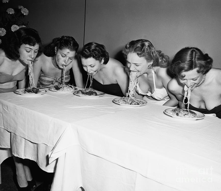 Women In A Spaghetti Eating Contest Photograph by Bettmann