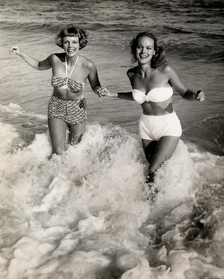Women Playing In The Surf At The Beach Photograph by George Marks