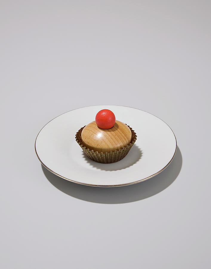 Wood Cupcake On White Plate With Grey Photograph by Rowan Fee