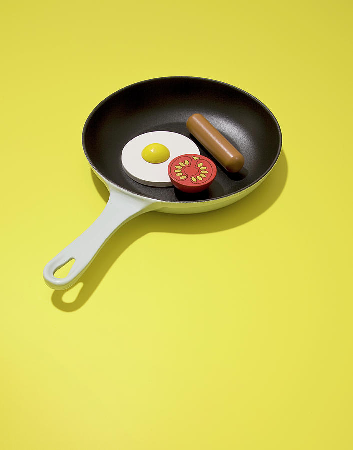 Wood Sausage, Egg And Tomato In Frying Photograph by Rowan Fee