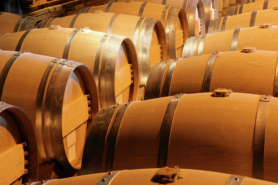 Wood Wine Barrels In Winery Cellar In Photograph by Yinyang