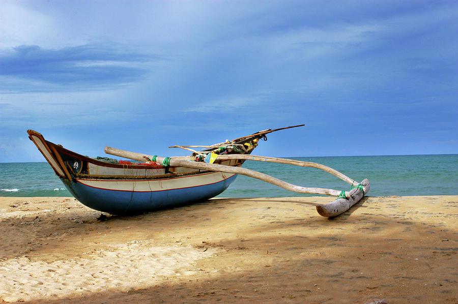 Wooden Catamaran By The Sea Shore Photograph by Juavenita Alphonsus