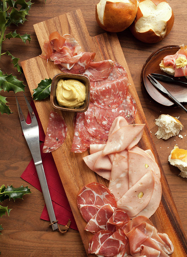 Wooden Platter With Sliced Deli Meats Photograph by Lisa Romerein