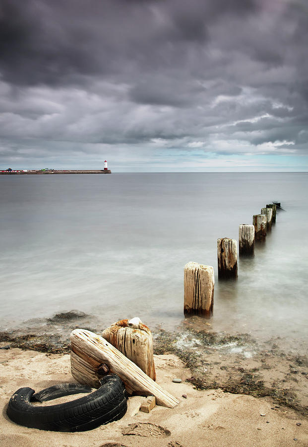 Wooden Posts In The Water Off The Coast Photograph by John Short / Design Pics