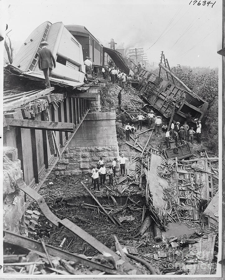 Workers On Train Wreck Debris Photograph by Bettmann