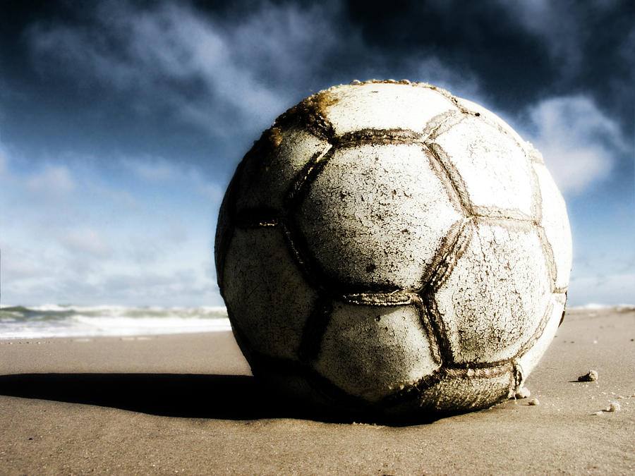 Worn And Old Soccer Ball On Sand Photograph by Vithib