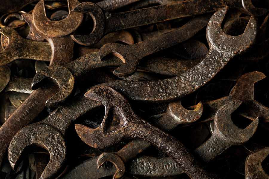Wrench Collection - old rusty tools in dramatic light by Art Whitton