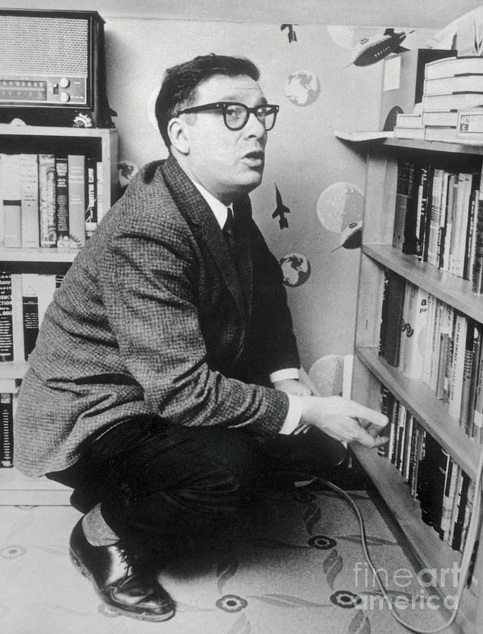 Writer Isaac Asimov Squatting Photograph by Bettmann