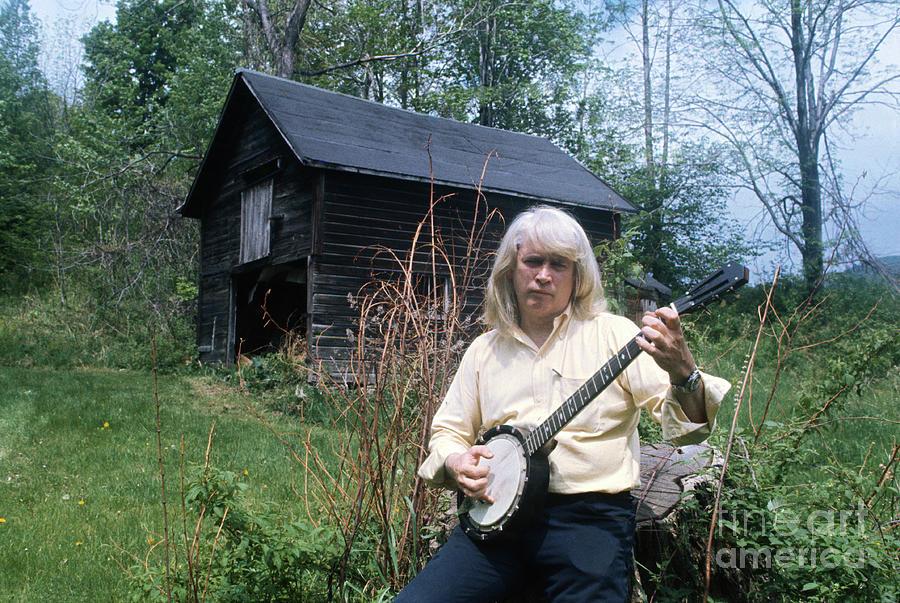 Writer John Gardner Playing The Banjo Photograph by Bettmann