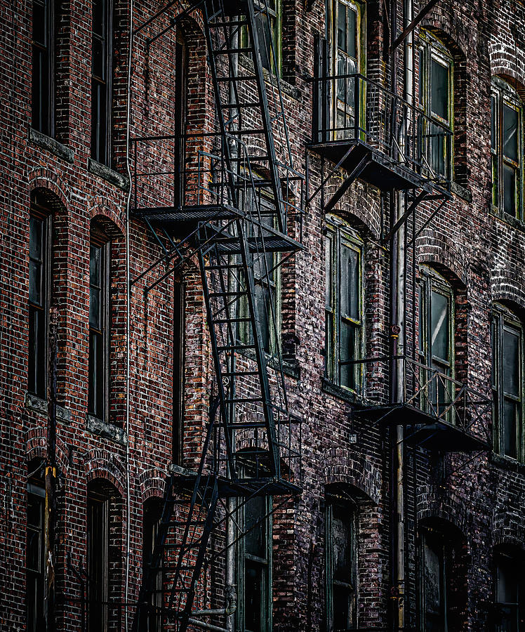 Wrought Iron Fire Escapes in Brick Alley by Darryl Brooks