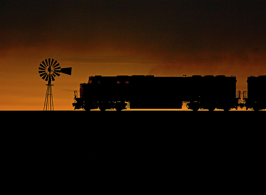 Wyoming Sunset With A Train Photograph by Tom Danneman