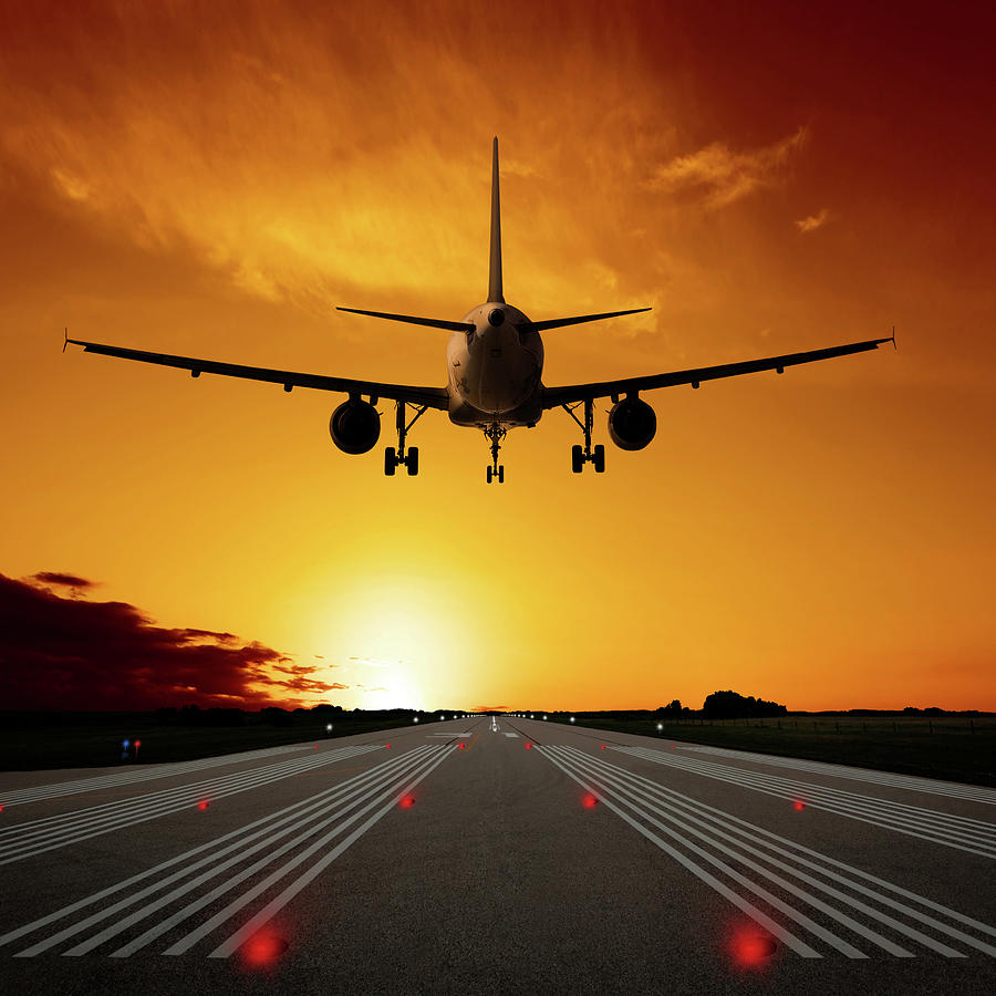 Xl Jet Airplane Landing At Sunset Photograph by Sharply done