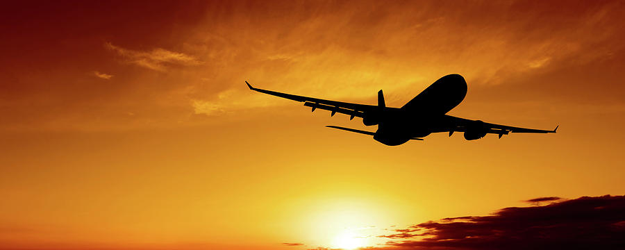 Xl Jet Airplane Taking Off At Sunset Photograph by Sharply done