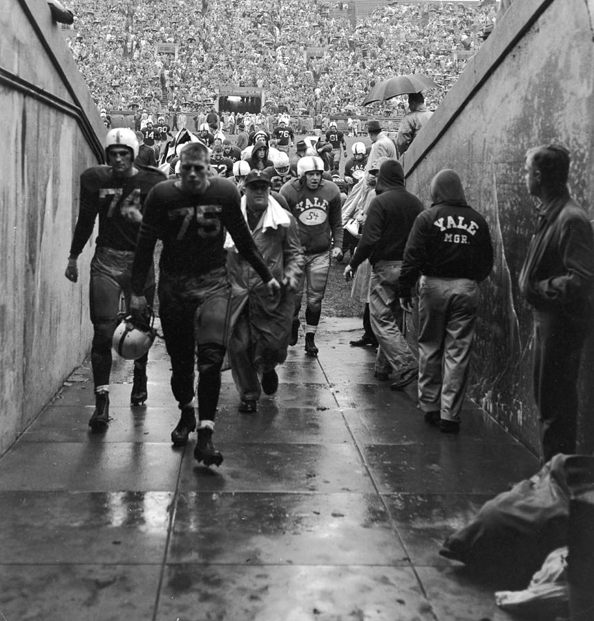 Yale Football Team Leaves Field Photograph by Getty Images