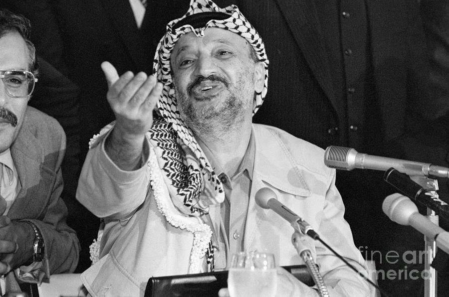 Yasser Arafat Gesturing At Microphone Photograph by Bettmann