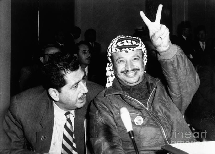 Yasser Arafat Giving Victory Sign Photograph by Bettmann