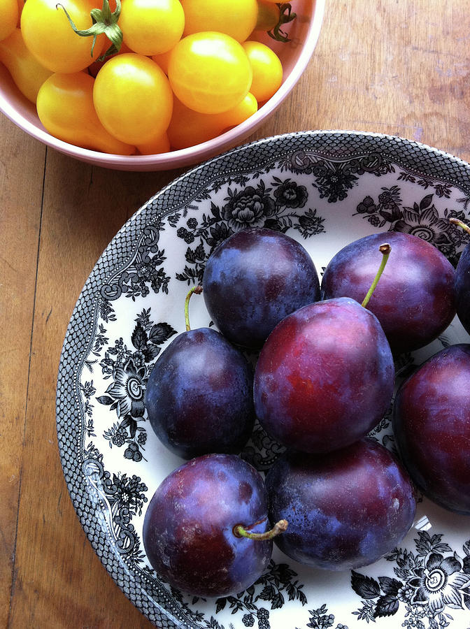 Yellow Cherry Tomatoes And Plums Photograph by Laura Johansen