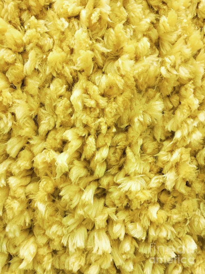 Yellow long pile carpet by Tom Gowanlock