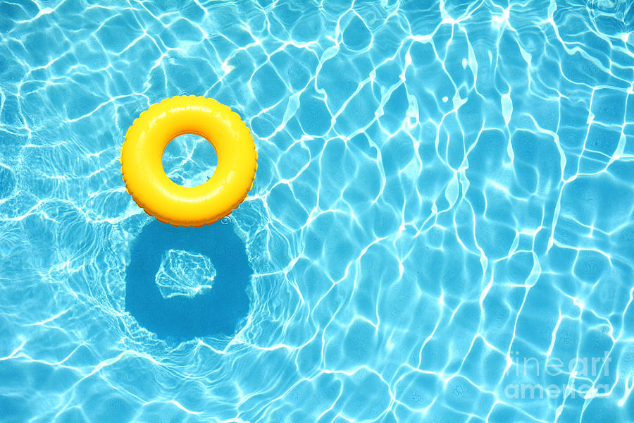 Color Photograph - Yellow Pool Float Ring Floating by Staciestauffsmith Photos