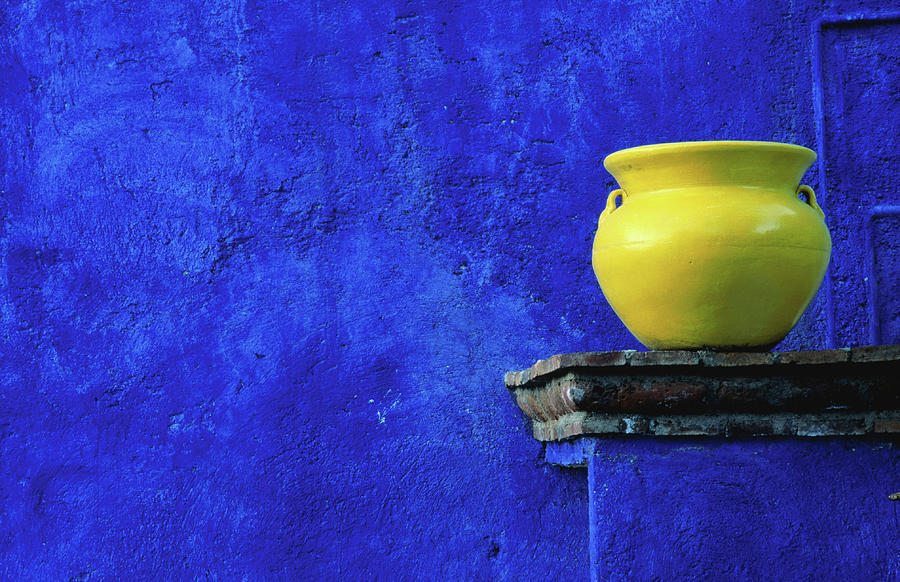 Yellow Pot And Blue Wall Photograph by Douglas Steakley