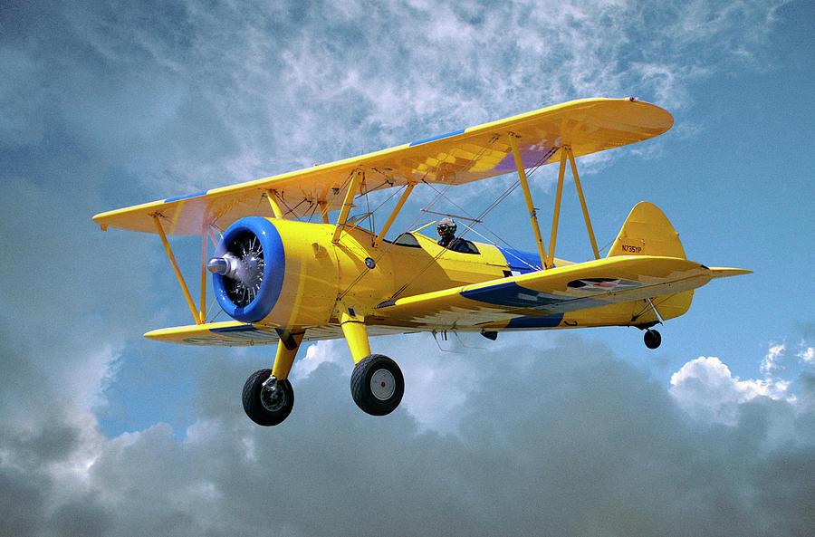 Yellow Stearman 5yp Bi-plane Flying In Photograph by Diane Miller